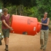 Eco warriors carrying up the water tank.